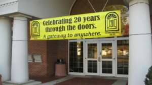 20th anniversary banner at front door of Jay County Public Library