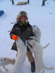 Karen Land with white dogs around