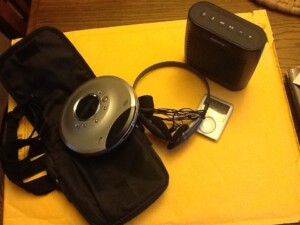 walkman cd player and earphones and ipod and bluetooth speaker