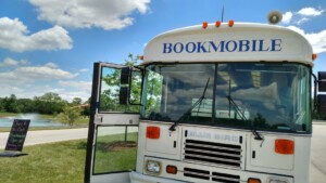 Bookmobile under blue skies at Hudson Park
