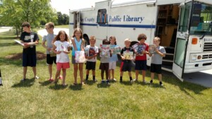 Readers with books checked out from bookmobile